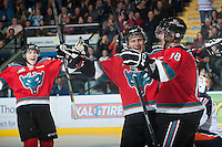 KELOWNA, CANADA - NOVEMBER 1:  Cody Fowlie #18, Filip Vasko #10 and Rourke Chartier #14 of the Kelowna Rockets celebrate a goal on the ice against the  Kamloops Blazers at the Kelowna Rockets on November 1 2012 at Prospera Place in Kelowna, British Columbia, Canada (Photo by Marissa Baecker/Shoot the Breeze) *** Local Caption ***