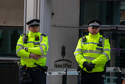 © Licensed to London News Pictures. 14/02/2020. London, UK. Police outside the Home Office as students climate change strikers demonstrate on the streets of Westminster to protest against the Governments's lack of action on the climate crisis. Photo credit: Alex Lentati/LNP