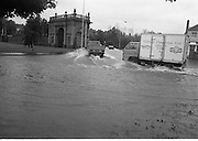 "Flooding at the Dodder..1986..226.08.1986..08.26.1986..28th August 1986..As a result of Hurricane Charly (Charlie) heavy overnight rainfall was the cause of severe flooding in the Donnybrook/Ballsbridge areas of Dublin. In a period of just 12 hours it was stated that 8 inches of rain had fallen. The Dodder,long regarded as a ""Flashy"" river, burst its banks and caused great hardship to families in the 300 or so homes which were flooded. Council workers and the Fire Brigades did their best to try and alleviate some of the problems by removing debris and pumping out some of the homes affected..Note: ""Flashy"" is a term given to a river which is prone to flooding as a result of heavy or sustained rainfall...Vans and trucks cause a small tidal wave as they negotiate the flood waters."