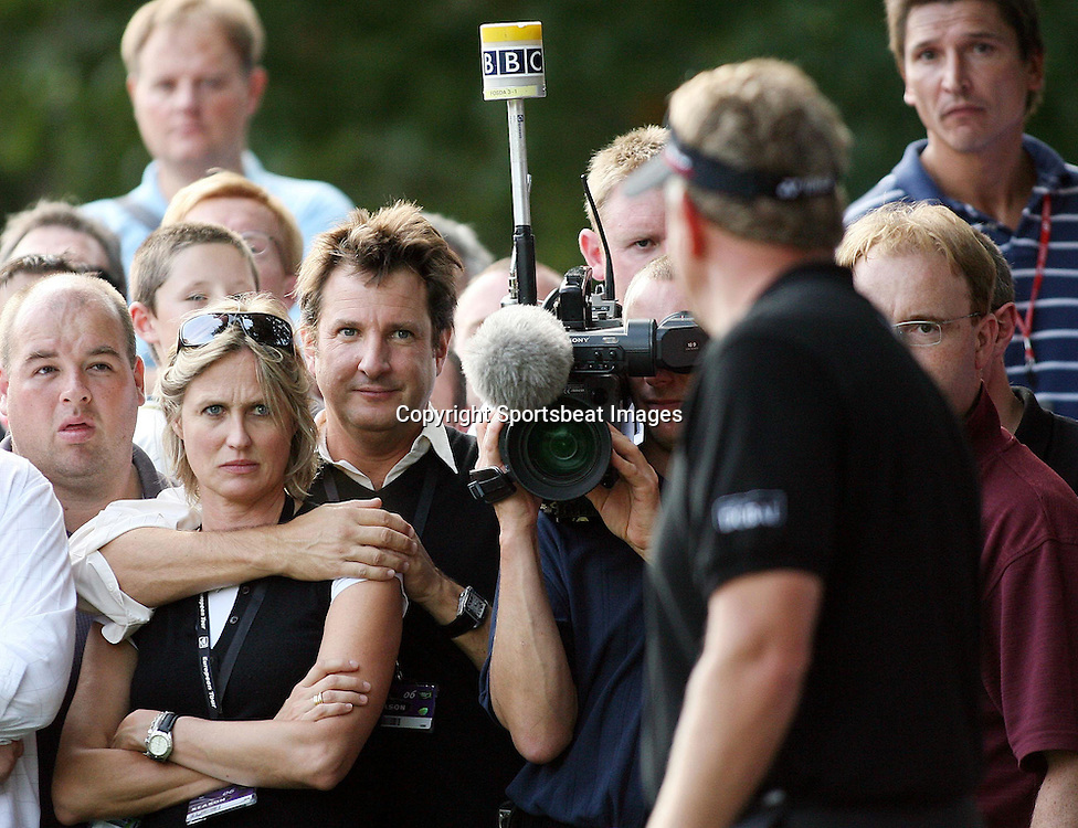 Photo: Chris Ratcliffe.<br /> HSBC World Match Play Championship, Wentworth. 15/09/2006.<br /> Colin Montgomerie on the 15th in the rough as Mark Nicholas, the cricket commentator watches on.