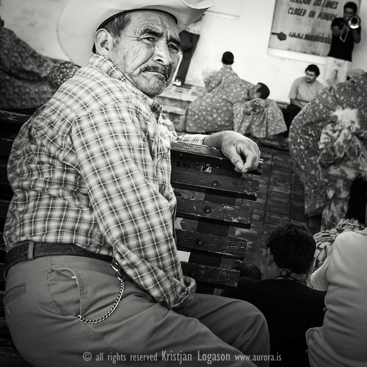 Old man watching the kids at a fiesta festival