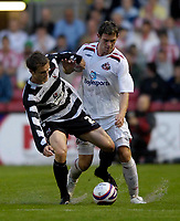 Photo: Jed Wee/Sportsbeat Images.<br /> Darlington v Sunderland. Pre Season Friendly. 18/07/2007.<br /> <br /> Sunderland's Daryl Murphy (R) is tackled by Darlinton's Scott Wiseman in the wet weather.