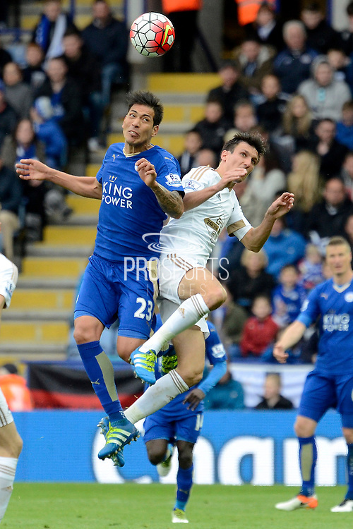 Leicester City forward Leonardo Ulloa and Swansea City midfielder Jack Cork challenge for a header during the Barclays Premier League match between Leicester City and Swansea City at the King Power Stadium, Leicester, England on 24 April 2016. Photo by Alan Franklin.