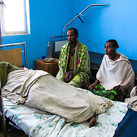 In rural Ethiopia, familes serve as nurses for a loved one who is admitted to a hospital in Motta.