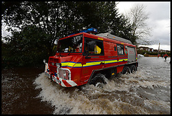 The Fire Brigade drive through  Wraysbury floods. Parts of the UK continues to be flooded in certain areas, Wraysbury, United Kingdom, Tuesday, 11th February 2014. Picture by Andrew Parsons / i-Images