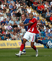 Photo: Tony Oudot.<br /> Gillingham v Charlton Athletic. Pre Season Friendly. 28/07/2007.<br /> Chris Iwelumo of Charlton is held back by Simon King of Gillingham and a penalty is awarded