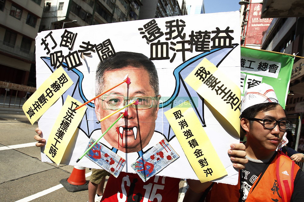 May 1, 2017 - Hong Kong, CHINA - Mockery image of Tommy Cheung, a local lawmaker and the capitalist represent restaurant & catering industries in the functional constituency who has been an avid advocate for suppressing minimum hourly wages for years is displayed during annual May Day Parade on the street of Hong Kong. May-1,2017.Hong Kong.ZUMA/Liau Chung Ren (Credit Image: © Liau Chung Ren via ZUMA Wire)