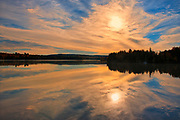 Clouds at sunrise reflected in the Saint John River <br />