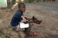 Haitian boy and chicken. Souvenance, Haiti, January 23, 2008.