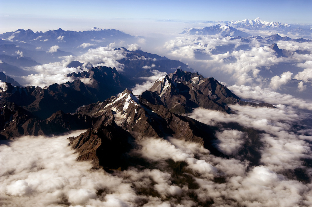 TIBET (China).The Eastern himalayas jut above the clouds, with Gyala Peri in the distance, a 7,000 metre peak.