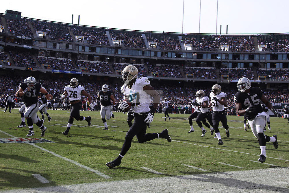 New Orleans Saints safety Malcolm Jenkins (27) returns a interception against the Oakland Raiders during an NFL game on Sunday, Nov. 18, 2012 at the Oakland Coliseum in Oakland, Ca.  (photo by Jed Jacobsohn)