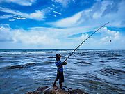 07 OCTOBER 2017 - COLOMBO, SRI LANKA: A man fishes on a jetty in a fishing village south of downtown Colombo, Sri Lanka. Fish is an important source of protein for most Sri Lankans.   PHOTO BY JACK KURTZ