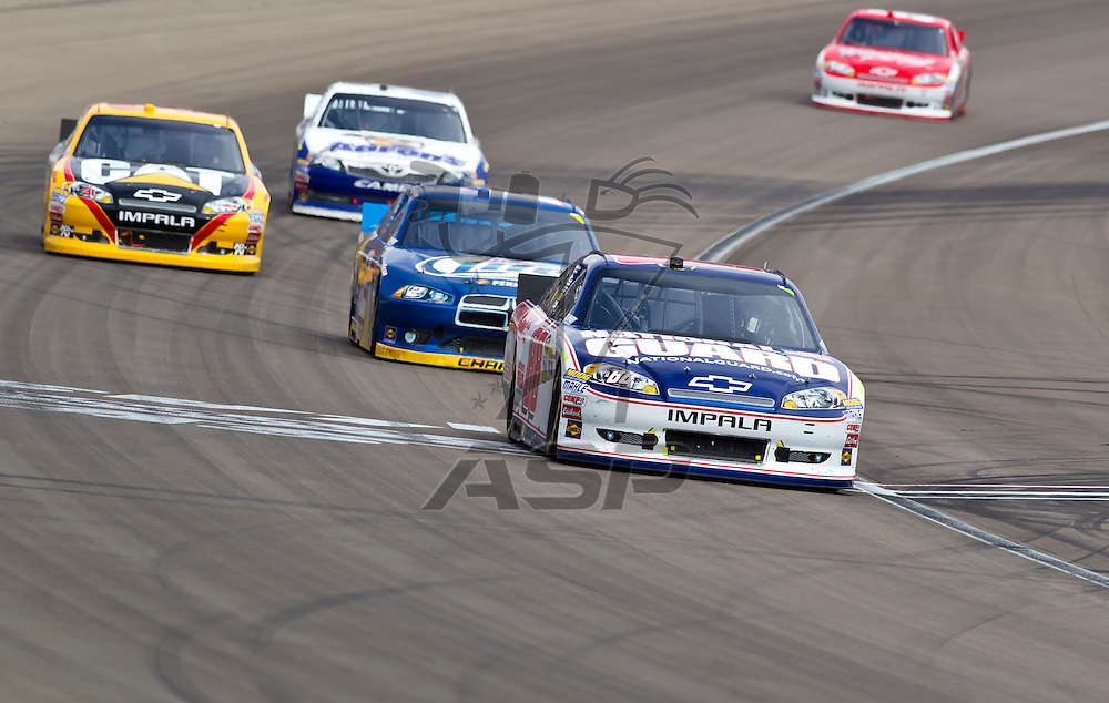 LAS VEGAS, NV - MAR 11, 2012:  Dale Earnhardt, Jr. (88), Brad Keselowski (2), Jeff Burton (31) and Mark Martin (55) battle for position during the Kobalt Tools 400 race at the Las Vegas Motor Speedway in Las Vegas, NV.
