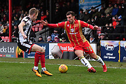 Grimsby Town defender Luke Hendrie (27) and MK Dons defender Baily Cargill (26) during the EFL Sky Bet League 2 match between Grimsby Town FC and Milton Keynes Dons at Blundell Park, Grimsby, United Kingdom on 26 January 2019.
