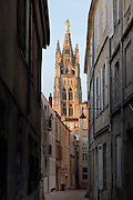 Rue de Bordeaux and the Tour Pey-Berland, a freestanding belltower built 1440-1500 and named for archbishop Pey Berland, at the Cathedrale Saint-Andre de Bordeaux, or Bordeaux Cathedral, Bordeaux, Aquitaine, France. The tower is listed as a historic monument and the cathedral, consecrated by Pope Urban II in 1096, although the existing Gothic building dates to the 14th and 15th centuries, is a UNESCO World Heritage Site as part of the Santiago de Compostela pilgrimage route. Picture by Manuel Cohen