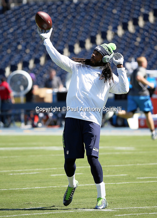 Seattle Seahawks cornerback Richard Sherman (25) throws a pregame pass while warming up before the 2015 NFL preseason football game against the San Diego Chargers on Saturday, Aug. 29, 2015 in San Diego. The Seahawks won the game 16-15. (©Paul Anthony Spinelli)
