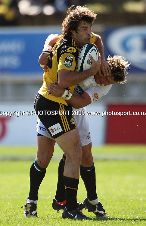 Conrad Smith tries to fend off Cheetahs flyhalf Jaques-Louis Potgeiter.<br /> Super 14 rugby union match, Hurricanes v Cheetahs at Yarrows Stadium, New Plymouth, New Zealand. Saturday 7 March 2009. Photo: Dave Lintott/PHOTOSPORT