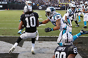 Oakland Raiders wide receiver Seth Roberts (10) catches a pass in the end zone that is good for a two point conversion that ties the score at 32-32 as he is about to take a hard hit from Carolina Panthers strong safety Kurt Coleman (20) during the 2016 NFL week 12 regular season football game against the Carolina Panthers on Sunday, Nov. 27, 2016 in Oakland, Calif. The Raiders won the game 35-32. (©Paul Anthony Spinelli)