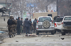 Afghan security officers carry a victim of a suicide car bombing onto an ambulance in Kabul, Afghanistan, on Jan. 16, 2013. A powerful blast rocked Afghan capital Kabul on Wednesday leaving over a dozen dead and injured, an eye witness said,  January 16, 2013. Photo by Imago / i-Images...UK ONLY