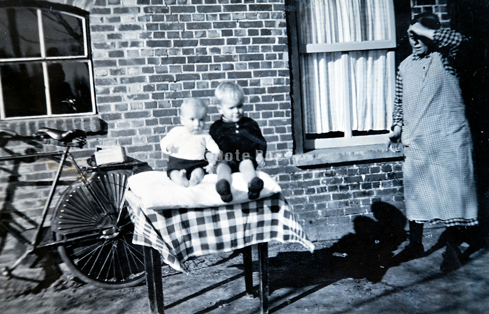 grandmother with two toddlers Holland 1950s