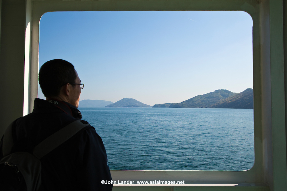 Inland Sea Ferryboat en route to Naoshima which is an island known for its many contemporary art museums.  Benesse Corporation, one of the largest education companies in Japan, has directed the creation and operation of the island's museums and other projects since the late 1980s.