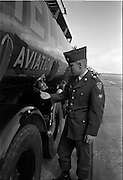 26/06/1963<br /> 06/26/1963<br /> 26 June 1963<br /> Irish Shell and BP fuel tankers for the helicopters of President John F. Kennedy under guard at Dublin Airport. Eatz checks the seal on the tanker.