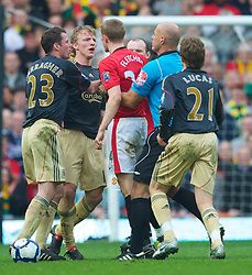 MANCHESTER, ENGLAND - Sunday, March 21, 2010: Referee Howard Webb constrains team-mate Manchester United's Darren Fletcher to prevent him being sent off after Fletcher violently reacting to a Dirk Kuyt (hidden) challenge, despite committing the original foul during the Premiership match at Old Trafford. (Photo by: David Rawcliffe/Propaganda)