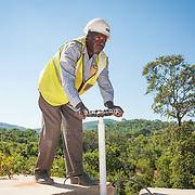 CAPTION: Isaac checks a junction box, part of the Kufandada River Protection and Irrigation Scheme Project. LOCATION: Bikita District, Masvingo Province, Zimbabwe. INDIVIDUAL(S) PHOTOGRAPHED: Isaac Magara.