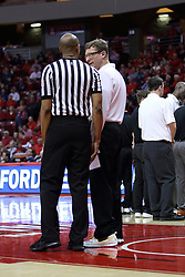 20 January 2017:   Luke Yaklich speaks with Bert Smith during an NCAA Missouri Valley Conference mens basketball game Where the Purple Aces of Evansville lost to the Illinois State Redbirds 75-73 in Redbird Arena, Normal IL