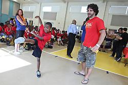 August 4, 2011; Philadelphia, PA; USA; Charlie Brenneman speaks to children at the Boys & Girls Club in Philadelphia.