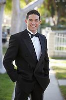 Portrait of man in tuxedo outdoors