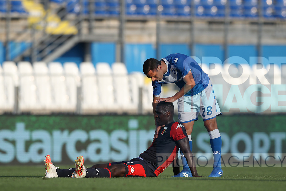 Brescia Calcio's Italian midfielder Romulo gives a pat on the head to Genoa's Colombian defender Christian Zapata after the final whistle of the Serie A match at Stadio Mario Rigamonti, Brescia. Picture date: 27th June 2020. Picture credit should read: Jonathan Moscrop/Sportimage
