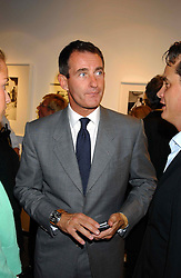 TIM JEFFERIES at a party to celebrate the opening of an exhibition of photographs by the late Norman Parkinson held at Hamiltons gallery, 13 Carlos Place, London W1 on 14th September 2004.<br />