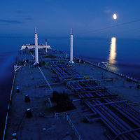 USA, Alaska, Oil tanker Arco Juneau sails off coast of southeast Alaska past rising full moon