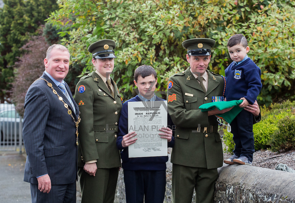 23/10/2015       <br /> Members of the Defence Forces were in Abbeyfeale today to present a handmade Tricolour and a copy of the Proclamation of the Irish Republic to students of the town's two primary schools.<br /> <br /> St Marys Boys National School and Scoil Mh&aacute;thair D&eacute; are among 3,000 schools nationally and 152 Limerick primary schools to receive the presentation as part of initiatives to mark the centenary of the 1916 Rising.&nbsp;<br /> <br /> Councillor Liam Galvin, Mayor of the City and County of Limerick joined pupils and teachers for today's presentation ceremony, which saw representatives of the Defences Forces raise the flag and read the Proclamation. <br /> <br /> Attending the ceremony at St. Marys Boys National School were, Mayor of Limerick Cllr. Liam Galvin, Private Ciara Quinn, Mark Roche, 12 and Sergeant James Reddan handing over the Tricolur to 4 year old pupil Dillon O'Brien. Picture: Alan Place.