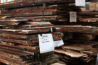 Rare raw Koa lumber sits waits to be used by Taylor Guitars in San Diego.
