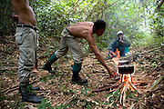 Rangers make a camp whilst on patrol in the forest. The forest rangers are employed by the Ministry of Environment but sponsored by Flora and Fauna International who pays them 75% of their salary and provides training and accommodation. They undertake regular patrols in to the Samkos Wildlife Sancturary which is part of the Cardamom Mountains Nature Reserve looking for illegal activites such as logging, poaching, land encroachment and the production of the illegal substance sassafras oil. The Cardamom Mountains and surrounding forests is the largest and most pristine area of intact forest in SE Asia. Covering an area of 2.5 million acres it became one of the last strong holds of a retreating Khmer Rouge. Their presence helped preserve the forest as no-one dared to venture inside. But with the Khmer Rouge gone, it faces new dangers from poachers, loggers and illegal drug factories. In charge of protecting this vast forest are a handful of rangers who's job it is to track down and arrest those who are helping to destroy this delicate habitat.