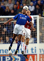 Photo. Matthew Lewis.<br />Leicester City v Arsenal. FA Barclaycard Premiership. 06/12/2003.<br /><br />Leicester's Les Ferdinand and Arsenal's Pascal Cyan contest for the ball.