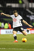 Derby County midfielder Jacob Butterfield strikes the ball during the Sky Bet Championship match between Derby County and Cardiff City at the iPro Stadium, Derby, England on 21 November 2015. Photo by Aaron Lupton.