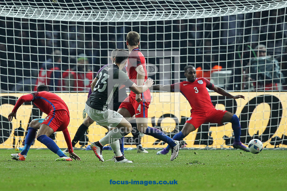 Mario Gomez of Germany has a shot on goal that is cleared off the line by Danny Rose of England during the International Friendly match at Olympiastadion Berlin, Charlottenburg-Wilmersdo<br /> Picture by Paul Chesterton/Focus Images Ltd +44 7904 640267<br /> 26/03/2016