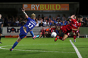 AFC Wimbledon midfielder Mitchell (Mitch) Pinnock (11) with a shot on goal during the EFL Sky Bet League 1 match between AFC Wimbledon and Walsall at the Cherry Red Records Stadium, Kingston, England on 21 August 2018.
