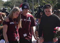 Brother and sister Liam and Anna Keiran comfort each other at the memorial garden outside Marjory Stoneman Douglas High School in Parkland, Fla. on Wednesday, February 14, 2019, on the anniversary of the shooting at the school. Photo by Joe Cavaretta/Sun Sentinel/TNS/ABACAPRESS.COM