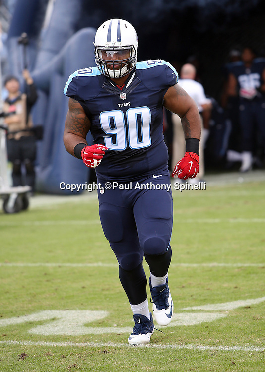 Tennessee Titans defensive end DaQuan Jones (90) runs onto the field during pregame player introductions before the 2015 week 7 regular season NFL football game against the Atlanta Falcons on Sunday, Oct. 25, 2015 in Nashville, Tenn. The Falcons won the game 10-7. (©Paul Anthony Spinelli)