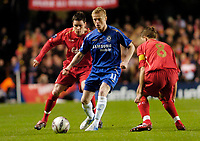 Photo: Leigh Quinnell.<br /> Chelsea v Liverpool. UEFA Champions League. <br /> 06/12/2005. Chelseas Damien Duff holds off Liverpools Steve Finnan and Steven Gerrard.