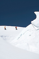 Mountain climbers walking past ice formation