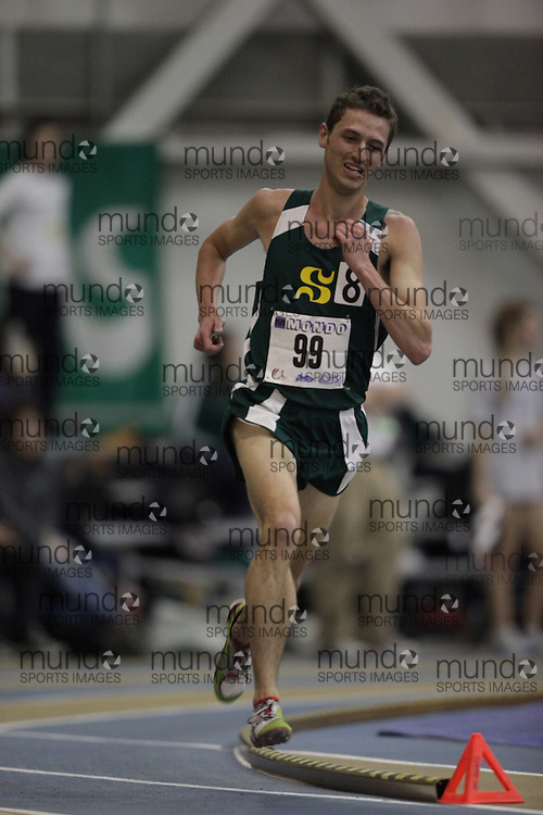 Windsor, Ontario ---13/03/09--- Alex Genest of  Universite de Sherbrooke competes in the mens 3000 metres at the CIS track and field championships in Windsor, Ontario, March 13, 2009..GEOFF ROBINS Mundo Sport Images