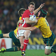 Shane Williams, Wales, is tackled by Robert Horne, (left) and Berrick Barnes, Australia, during the Australia V Wales Bronze Final match at the IRB Rugby World Cup tournament, Auckland, New Zealand. 21st October 2011. Photo Tim Clayton...