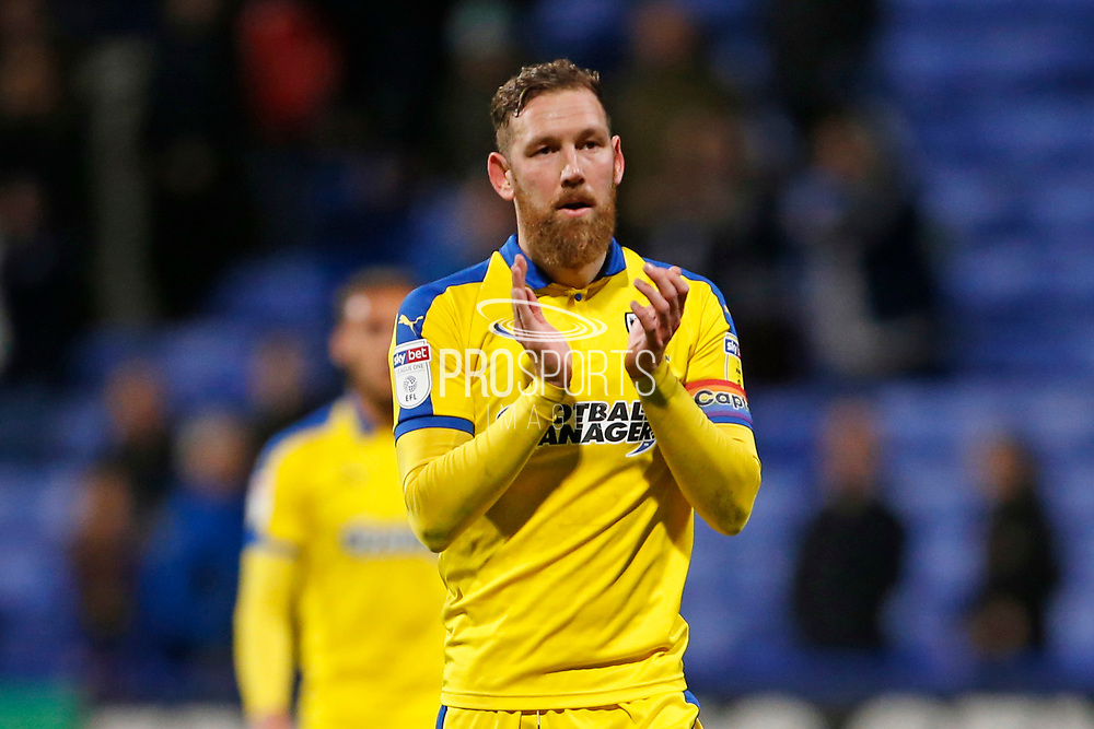 Disappointed  Scott Wagstaff of Wimbledon  applauds the fans at full time during the EFL Sky Bet League 1 match between Bolton Wanderers and AFC Wimbledon at the University of  Bolton Stadium, Bolton, England on 7 December 2019.