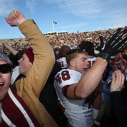 Harvard players and fans celebrate victory after the Yale V Harvard, Ivy League Football match at Yale Bowl. Harvard won the game 34-7 giving Harvard a share of the 2013 Ivy League title. The game was the 130th meeting between Harvard and Yale in the historic rivalry that dates back to 1875. New Haven, Connecticut, USA. 23rd November 2013. Photo Tim Clayton
