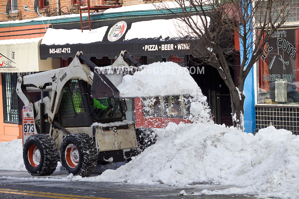 Middletown, New York - Middletown Department of Public Works employees clear snow from West Main Street after a snowstorm on Feb. 6, 2014.